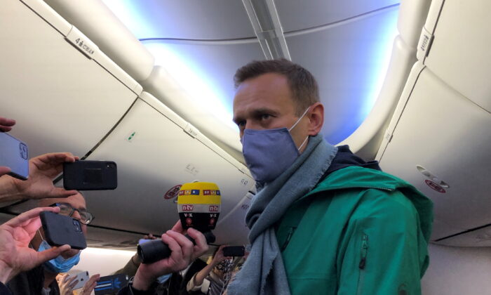 Russian opposition leader Alexei Navalny is seen on board a plane before the departure for the Russian capital Moscow at an airport in Berlin on Jan. 17, 2021. (Polina Ivanova/Reuters)