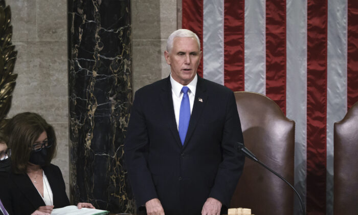 Vice President Mike Pence reads the final certification of Electoral College votes cast in November's presidential election during a joint session of Congress after working through the night, at the Capitol in Washington on Jan. 7, 2021. (J. Scott Applewhite, Pool)