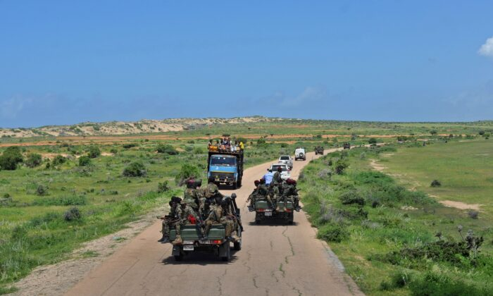 Somali soldiers patrol in convoy near Sanguuni military base, where an American special operations soldier was killed by a mortar attack on June 8, about 450 km south of Mogadishu, Somalia, on June 13, 2018. (Mohamed Abdiwahab/AFP via Getty Images)