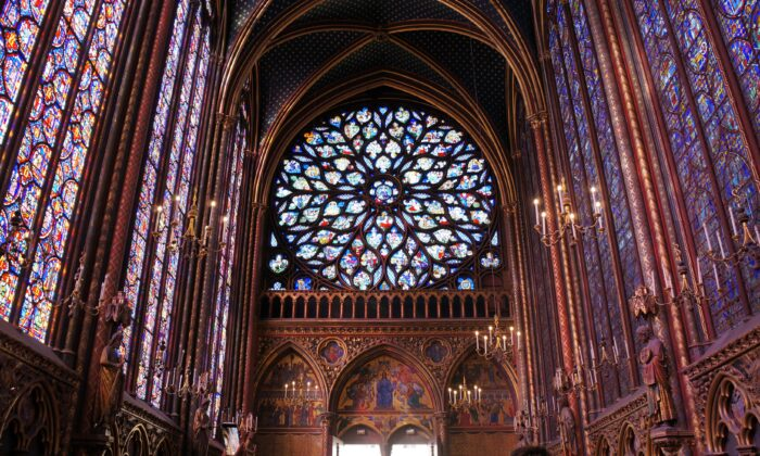 The 15th-century rose window in the Flamboyant Gothic style depicts St. John's vision of the Apocalypse. (Marie He/The Epoch Times)