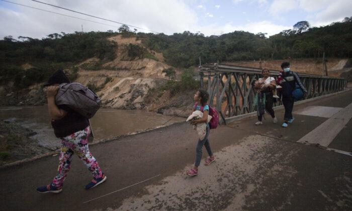 Migrants hoping to reach the distant U.S. border walk along a highway, in Jocotan, Guatemala, on Jan. 16, 2021.  (Sandra Sebastian/AP Photo)