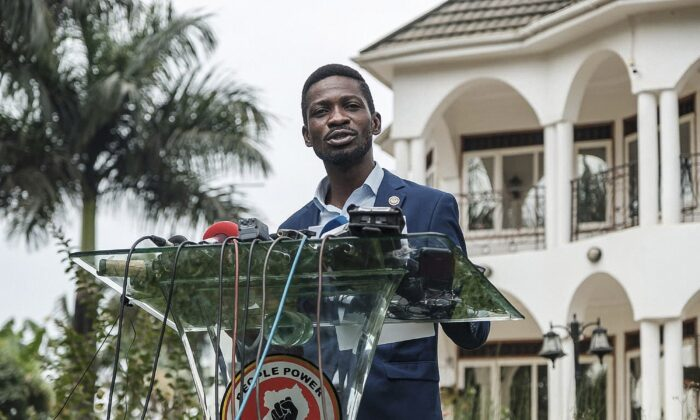 Musician-turned-politician Robert Kyagulanyi, also known as Bobi Wine, speaks during a press conference at his home in Magere, Uganda, on Jan. 15, 2021. (Sumy Sadruni/AFP via Getty Images)
