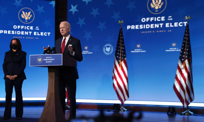 Then-President-elect Joe Biden (R) speaks at The Queen theater in Wilmington, Delaware, on Jan. 15, 2021. (Alex Wong/Getty Images)
