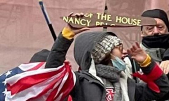 Woman Who Allegedly Posed With Pelosi's Nameplate During Capitol Storming Is Charged