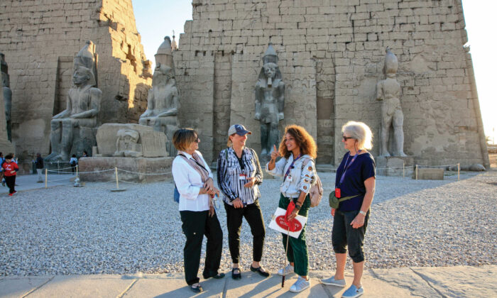 Members of an Overseas Adventure Travel tour group visit ancient monuments in Egypt. (Courtesy of the Grand Circle Corp.)
