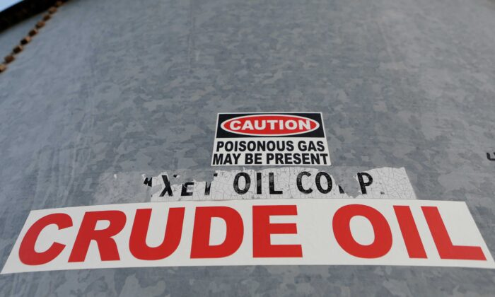 A sticker reads crude oil on the side of a storage tank in the Permian Basin in Mentone, Loving County, Texas, on Nov. 22, 2019. (Angus Mordant/Reuters)