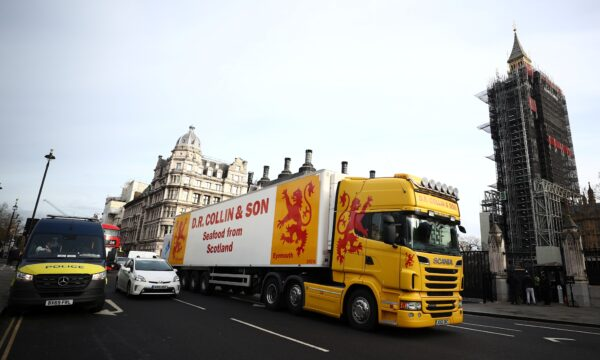 A lorry drives during a protest