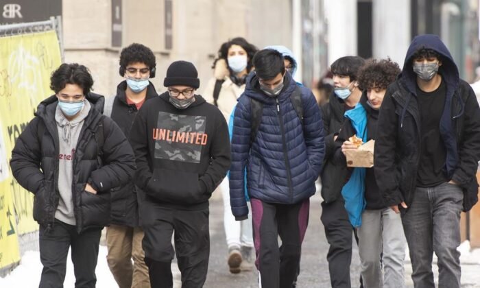People walk in downtown Montreal as COVID-19 lockdown measures continue, on Jan. 18, 2021. (Ryan Remiorz/The Canadian Press)