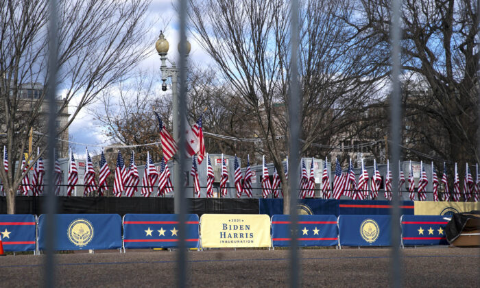 """Signs reading """"2021 Biden Harris Inauguration"""" can be seen within the expanded protective perimeter around the White House, in Washington on Jan. 17, 2021. (Sarah Silbiger/Getty Images)"""
