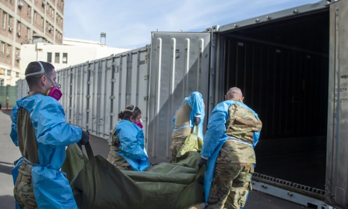 National Guard members assisting with processing COVID-19 deaths, placing them into temporary storage at the medical examiner-coroner's office in Los Angeles, Calif., on  Jan 12, 2021. (Los Angeles County Department of Medical Examiner-Coroner via AP, File)