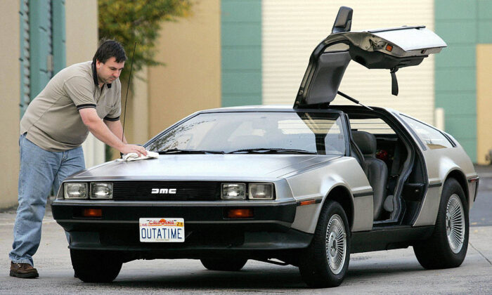Wayne Gillard polishes up his 1981 DeLorean DMC 12, one of only six in Australia and up for auction at a novelty auction, seen in this 15 July 2004 file photo in Melbourne.  (WILLIAM WEST/AFP via Getty Images)