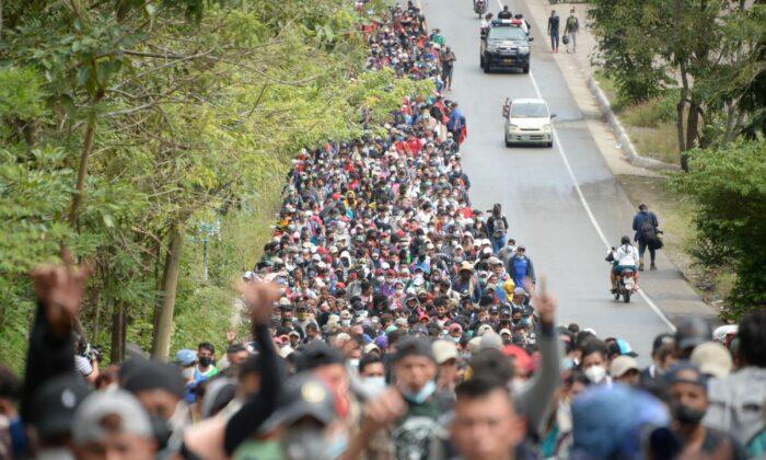 Honduran migrants, part of a caravan heading to the United States, walk along a road in Camotan, Guatemala, on Jan. 16, 2021. (Johan Ordonez/AFP via Getty Images)