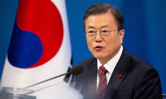South Korean President Moon Jae-in speaks during an on-line New Year press conference with local and foreign journalists at the Presidential Blue House in Seoul, South Korea, on Jan. 18, 2021. (Jeon Heon-kyun/Pool Photo via AP)