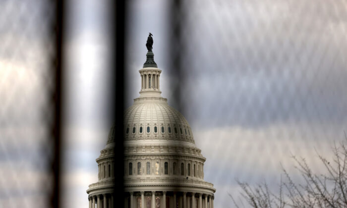 The U.S. Capitol dome is seen beyond a security fence in Washington, on Jan. 17, 2021. (Michael M. Santiago/Getty Images)