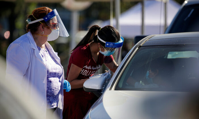 Mass-vaccination of health care workers against COVID-19 at Dodger Stadium in Los Angeles, on Jan. 15, 2021. (Irfan Khan/Pool via Reuters)