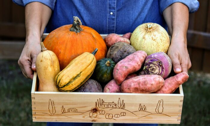 Buying locally grown produce, whether at a farmers market or through a CSA share, will help feed you well while supporting your community. (Jasmine Sahin/Shutterstock)