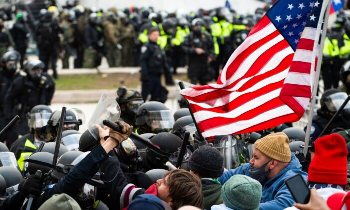 Protesters fight with riot police outside the Capitol building in Washington on Jan. 6, 2021. (Roberto Schmidt/AFP via Getty Images)