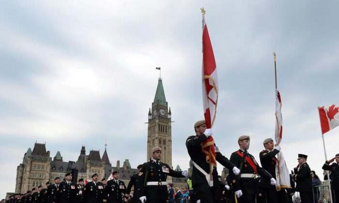 Soldiers parade from Parliament Hill as they take part in the National Day of Honour in Ottawa on May 9, 2014. Canada's veterans ombudsman is calling on the federal government reverse to restrictions on the provision of mental-health services for the families of retired military personnel. (Sean Kilpatrick/The Canadian Press)