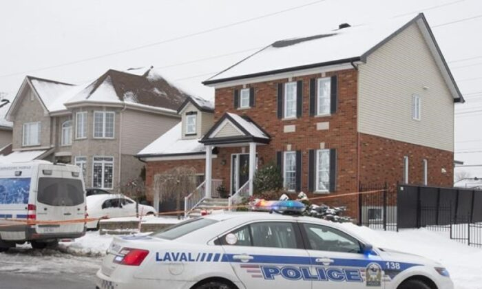 Police investigate the crime scene where a seven-year-old girl was found dead in her family's home on Jan. 4, 2021, in Laval, Que. (Ryan Remiorz/The Canadian Press)
