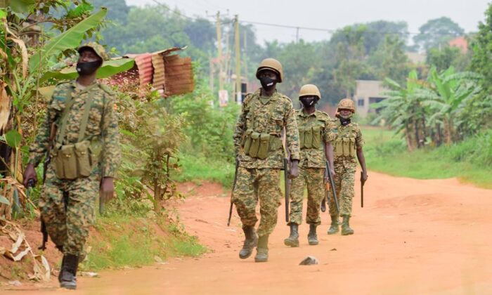 Soldiers patrol outside opposition challenger Bobi Wine's home in Magere, Kampala, Uganda, on Jan. 16, 2021, after President Yoweri Museveni was declared the winner of the presidential election. (AP Photo/Nicholas Bamulanzeki)