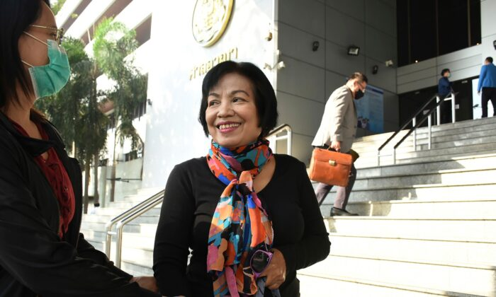A woman identified only by her first name Anchan (R) talks to her friend as she arrives at the Bangkok Criminal Court in Bangkok, Thailand, on Jan. 19, 2021. (AP Photo)