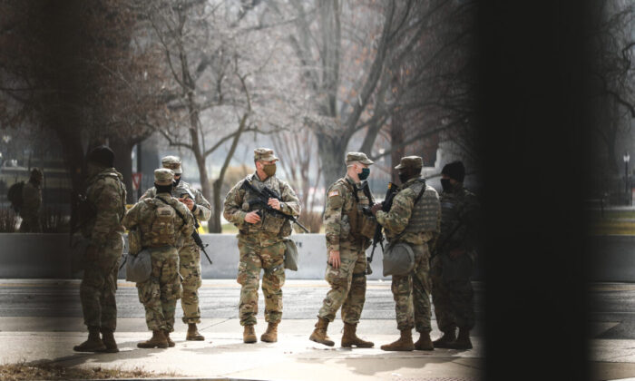 National Guard troops near the Capitol building in Washington on Jan. 15, 2021. (Charlotte Cuthbertson/The Epoch Times)