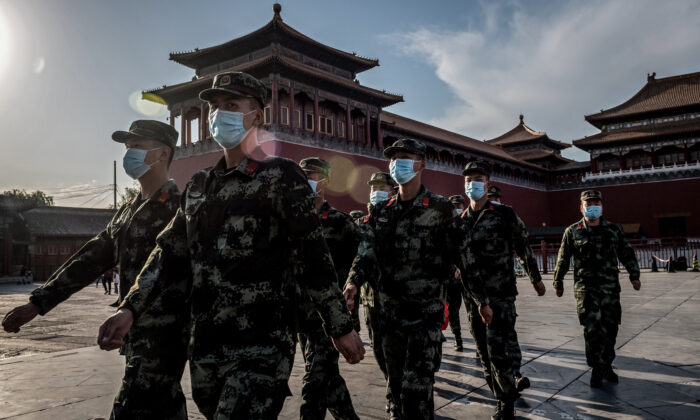 People's Liberation Army (PLA) soldiers march in front of the entrance of the Forbidden City in Beijing on May 19, 2020.  (NICOLAS ASFOURI/AFP via Getty Images)