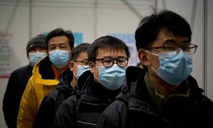 People arrive to be inoculated with a COVID-19 vaccine at the Chaoyang Museum of Urban Planning in Beijing, China on Jan. 15, 2021. (NOEL CELIS/AFP via Getty Images)