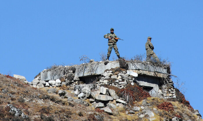 Indian Army personnel stand guard at Bumla pass at the India-China border in Arunachal Pradesh on Oct. 21, 2012. According to Indian media reports, the Chinese have built 101 houses, 2.5 miles inside the Indian territory in an area inside Arunachal Pradesh.