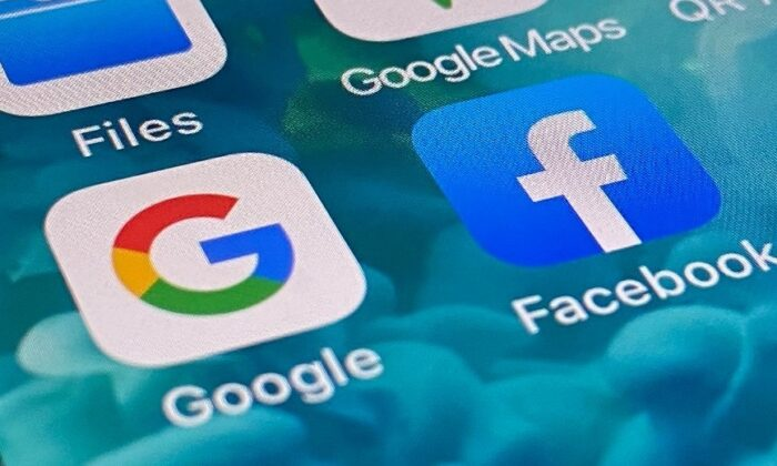 The mobile app icons of Google and Facebook on a smartphone in Sydney, Australia on Dec. 9, 2020 (The Epoch Times)