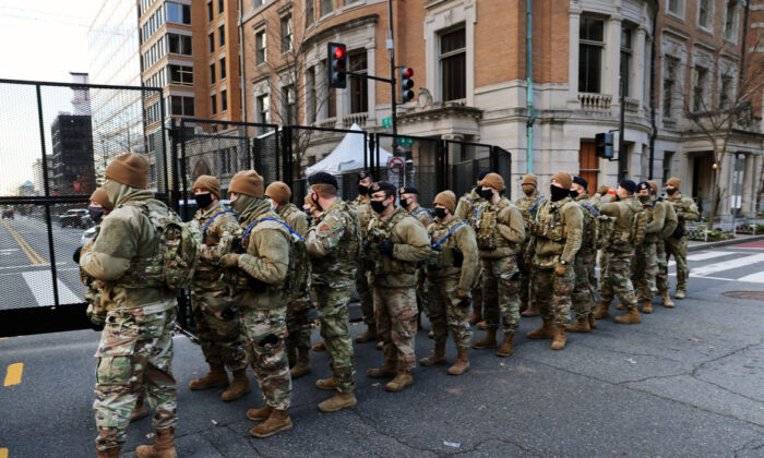 Members of the National Guard patrol the streets in Washington on Jan. 19, 2021. (Spencer Platt/Getty Images)