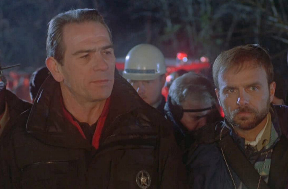 "two men in a crowd in the ""The Fugitive"""