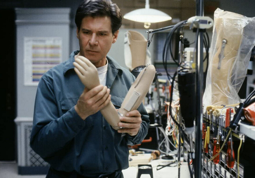 "man looks at prosthetic limb in ""The Fugitive"""