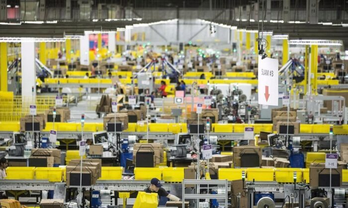 Employees work at the Amazon fulfillment centre in Brampton, Ont., on Nov. 26, 2018. Amazon says it plans to open open five facilities in Quebec. (Chris Young/The Canadian Press)