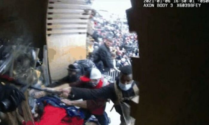 In this still image from video, a man identified as Emmanuel Jackson is seen beating police officers with a metal bat during the mayhem inside and outside the U.S. Capitol on Jan. 6, 2021. (FBI)