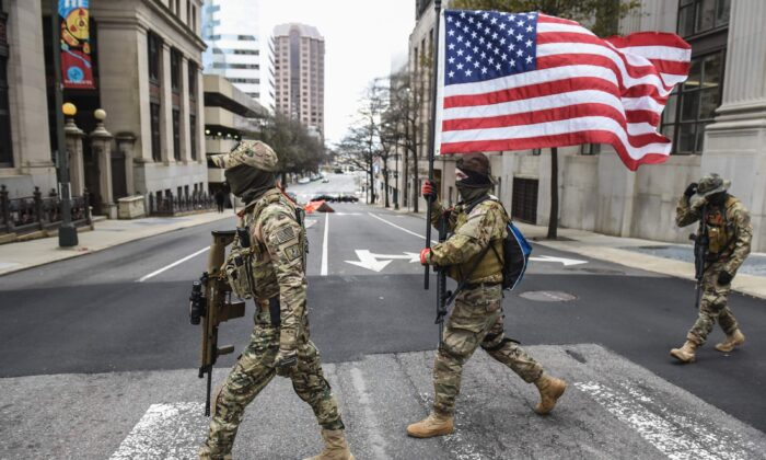 Members of a pro-gun group carry their weapons near the state Capitol in Richmond, Virginia, on Jan. 18, 2021. (Stephanie Keith/Getty Images)