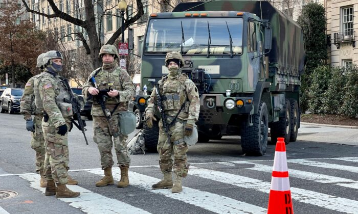National Guard troops stand guard in Washington on Jan. 19, 2021. (Daniel Slim/AFP via Getty Images)