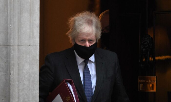 Britain's Prime Minister Boris Johnson leaves 10 Downing Street in London to take part in the weekly session of Prime Minister Questions (PMQs) at the House of Commons on Jan. 20, 2021. (Daniel Leal-Olivas/AFP via Getty Images)