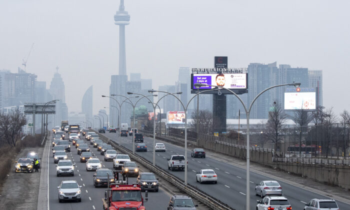 Heavy traffic leaves the downtown core in Toronto, Canada, on Jan. 14, 2021.(Frank Gunn/The Canadian Press)