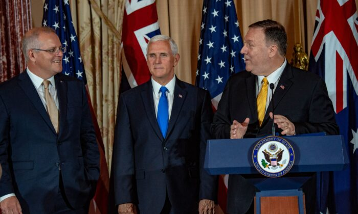 Australian Prime Minister Scott Morrison (L) listens to US Secretary of State Mike Pompeo (R) as US Vice President Mike Pence (C) looks on during a luncheon at the State Department in Washington, DC on September 20, 2019. ( ERIC BARADAT/AFP via Getty Images)
