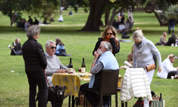 People have a picnic in a park in Melbourne on Oct. 18, 2020, as the state government announced a lifting of some COVID-19 restrictions. (William West/AFP via Getty Images)