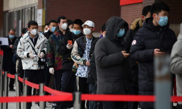 People line up outside a hospital to get COVID-19 tests in Beijing, China on Jan. 14, 2021. (GREG BAKER/AFP via Getty Images)