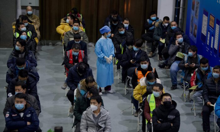 People wait to be inoculated with a COVID-19 vaccine at the Chaoyang Museum of Urban Planning in Beijing, on Jan. 15, 2021. (NOEL CELIS/AFP via Getty Images)