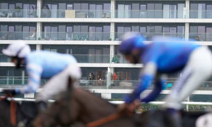 A general view as a resident of a flat that overlooks the course watches the action at Newbury Racecourse on January 20, 2021 in Newbury, England. (Alan Crowhurst/Getty Images)