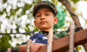 Flag-Carrying 11-Year-Old Takes Big Steps to Thank Law Enforcement