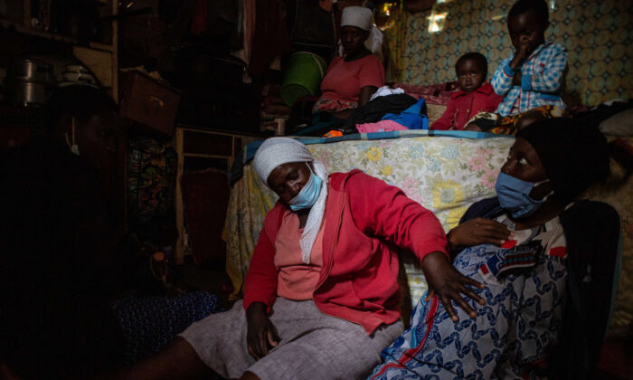 Midwife Angeless Kanzara examines a pregnant woman to assess whether she is ready to give birth, in Harare, Zimbabwe, on Jan. 14, 2021. (Tafadzwa Ufumeli/Getty Images)