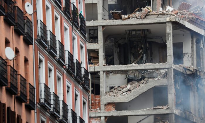 Smoke rises from a damaged building after an explosion in Madrid on Jan. 20, 2021. (Susana Vera/Reuters)