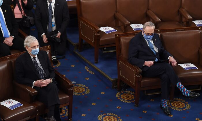 Senate Republican Leader Mitch McConnell (R-Ky.) (L) sits near Senate Democratic Leader Chuck Schumer (D-N.Y.) during a joint session of Congress in Washington on Jan. 6, 2021. (Olivier Douliery/Pool/AFP via Getty Images)
