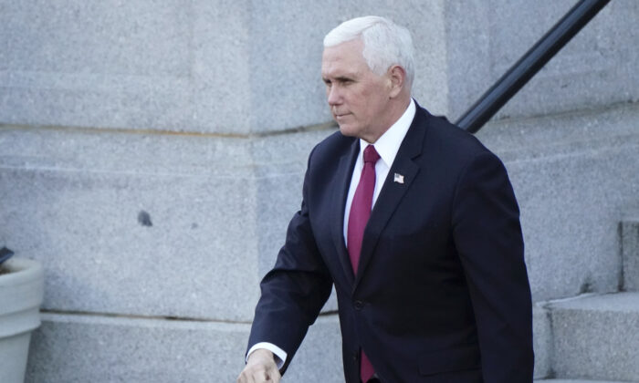 Vice President Mike Pence walks to the West Wing of the White House after addressing staff on the steps of the Eisenhower Executive Office Building, in the White House complex, on Jan. 19, 2021, in Washington. (AP Photo/Gerald Herbert)