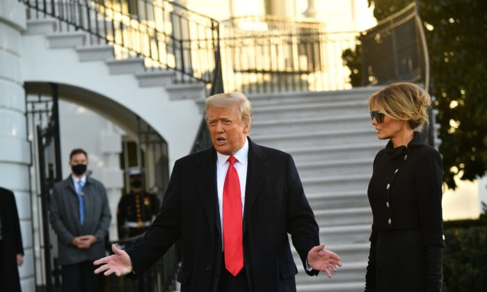 President Donald Trump and First Lady Melania Trump speak to the media before departing Washington for Florida, outside the White House on Jan. 20, 2021. (Mandel Ngan/AFP via Getty Images)